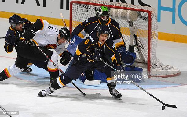 Mikael Kurki of Espoo Blues runs with the puck during the IIHF Champions Hockey League match between Espoo Blues and SC Bern on November 19, 2008 in...