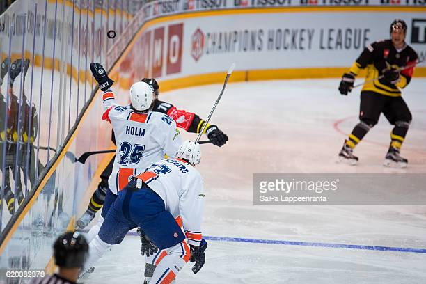 Mikael Kuronen of Lappeenranta challenges Philip Holm of Vaxjo during the Champions Hockey League Round of 16 match between SaiPa Lappeenranta and...