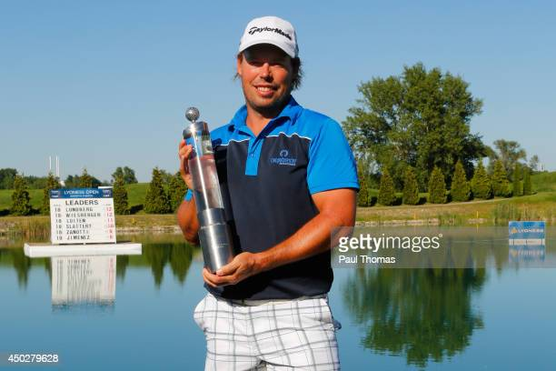 Mikael Lundberg of Sweden celebrates with the trophy during the Lyoness Open day four at the Diamond Country Club on June 8 2014 in Atzenbrugg Austria