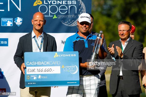 Mikael Lundberg of Sweden is presented the winners cheque by Mathias Vorback of Lyoness during the Lyoness Open day four at the Diamond Country Club...