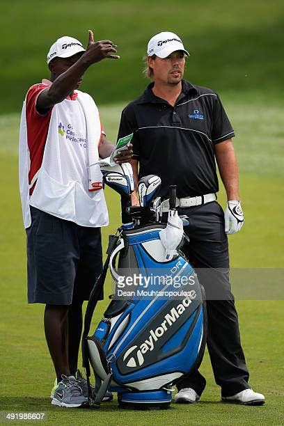 Mikael Lundberg of Sweden speaks to his caddie before he hits his second shot on the 1st hole during the final round of the Open de Espana held at...