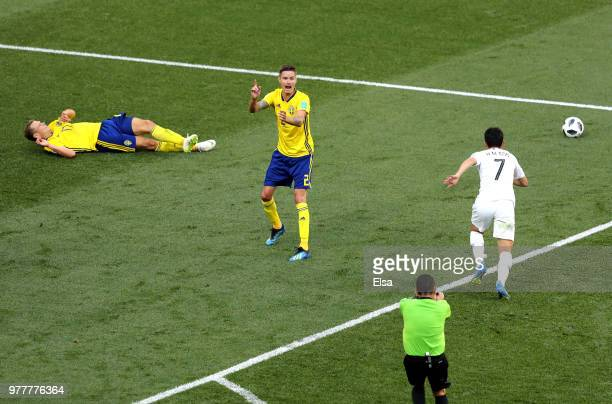Mikael Lustig appeals to Referee Joel Aguilar to look at VAR after Kim MinWoo of Korea Republic fouls Viktor Claesson of Sweden inside the box...