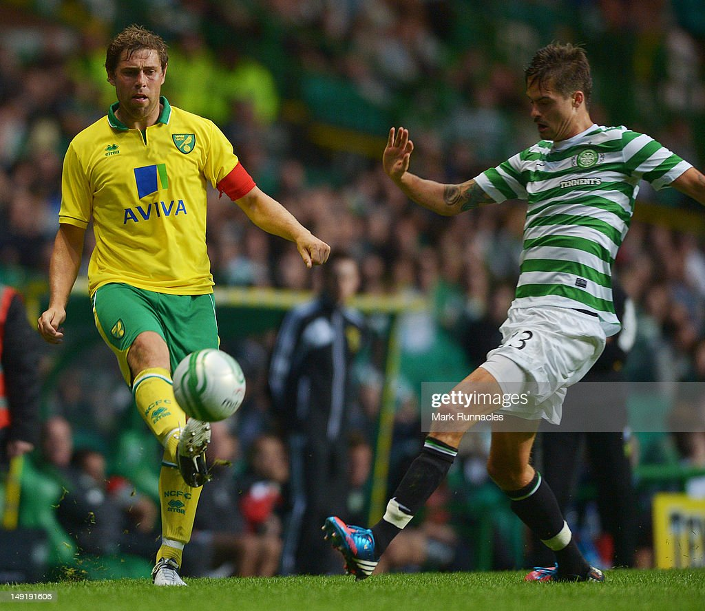 Mikael Lustig of Celtic and Grant Holt of Norwich City during the pre-season friendly match between Celtic and Norwich City, at ParkHead Stadium on July 24, 2012 in Glasgow, Scotland.
