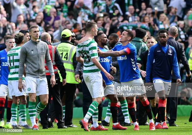 Mikael Lustig of Celtic and James Tavernier of Rangers confront one another at the final whistle during the Ladbrokes Scottish Premiership match...