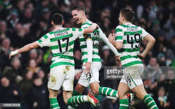 Mikael Lustig of Celtic celebrates with Ryan Christie after he scores his team's fourth goal during the Scottish Ladbrokes Premiership match between...