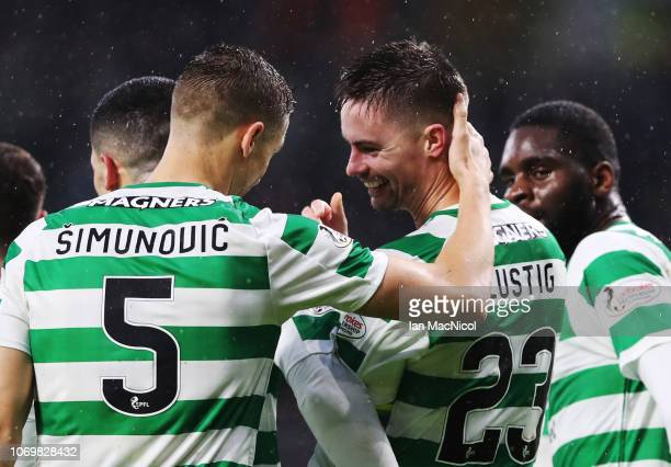 Mikael Lustig of Celtic celebrates with team mates after he scores his team's third goal during the Scottish Ladbrokes Premiership match between...