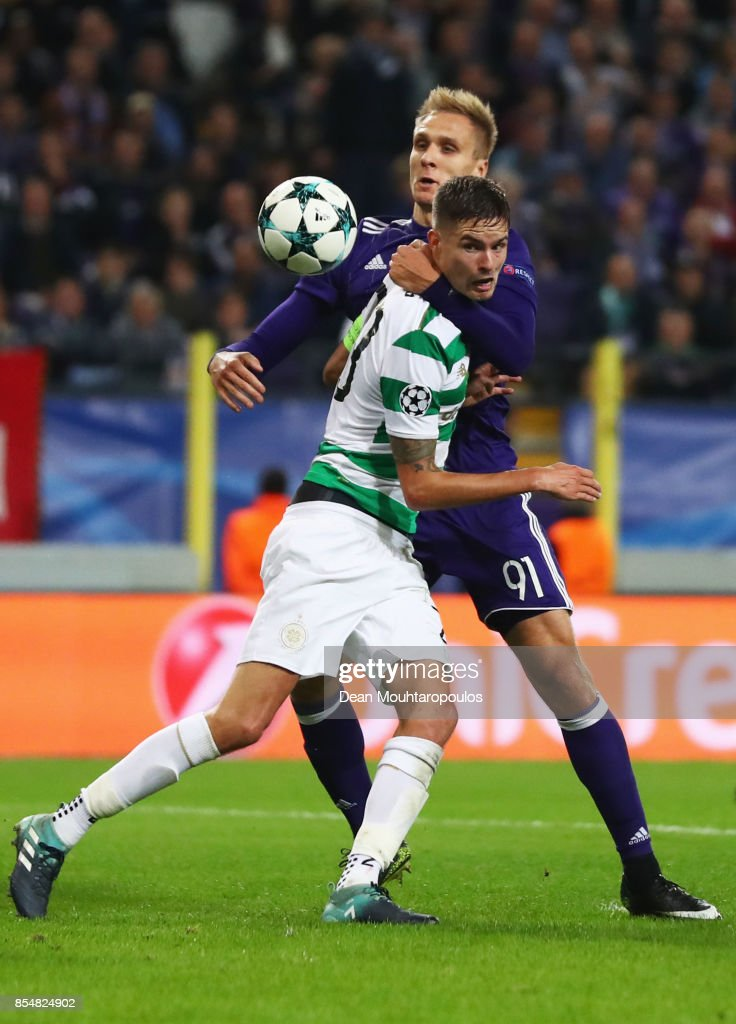 Mikael Lustig of Celtic holds off Lukasz Teodorczyk of RSC Anderlecht during the UEFA Champions League group B match between RSC Anderlecht and Celtic FC at Constant Vanden Stock Stadium on September 27, 2017 in Brussels, Belgium.
