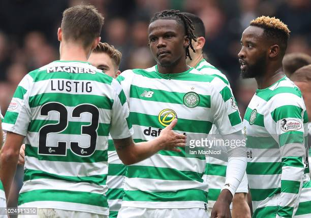 Mikael Lustig of Celtic is seen celebrating after Dedryck Boyata of Celtic scores during the Scottish Premier League match between Celtic and...
