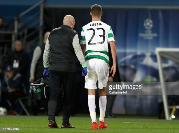 Mikael Lustig of Celtic leaves the field injured during the UEFA Champions League group B match between Paris SaintGermain and Celtic FC at Parc des...