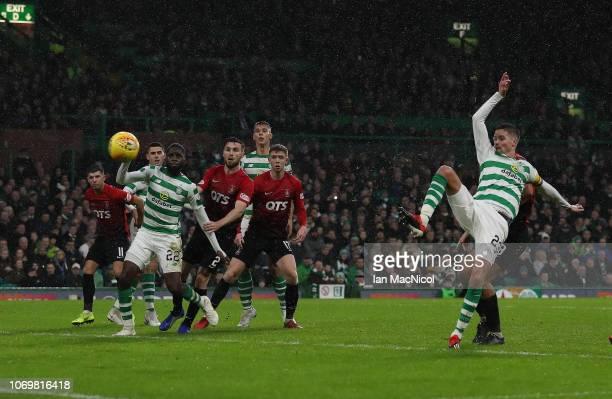 Mikael Lustig of Celtic scores his team's third goal during the Scottish Ladbrokes Premiership match Celtic and Kilmarnock at Celtic Park Stadium on...