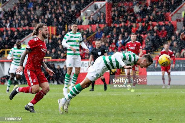 Mikael Lustig of Celtic scores the opening goal during the Ladbrokes Scottish Premiership match between Aberdeen and Celtic at Pittodrie Stadium on...