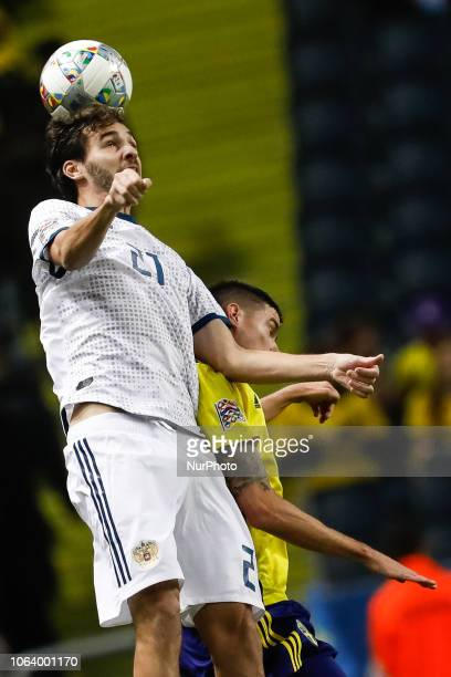 Mikael Lustig of Sweden and Aleksandr Erokhin of Russia vie for a header during the UEFA Nations League B Group 2 match between Sweden and Russia on...