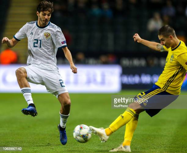 Mikael Lustig of Sweden and Aleksandr Erokhin of the Russia vie for the ball during the UEFA Nations League B group two match between Sweden and...