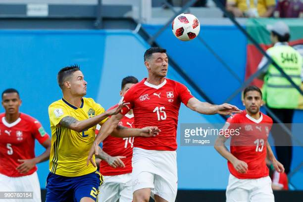 Mikael Lustig of Sweden and Blerim Dzemaili of Switzerland battle for the ball during the 2018 FIFA World Cup Russia Round of 16 match between Sweden...