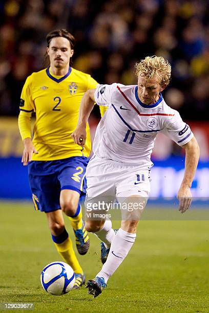 Mikael Lustig of Sweden and Dirk Kuyt of Holland in action during the EURO 2012 Qualifying match between Sweden and Netherlands at the Rasunda...