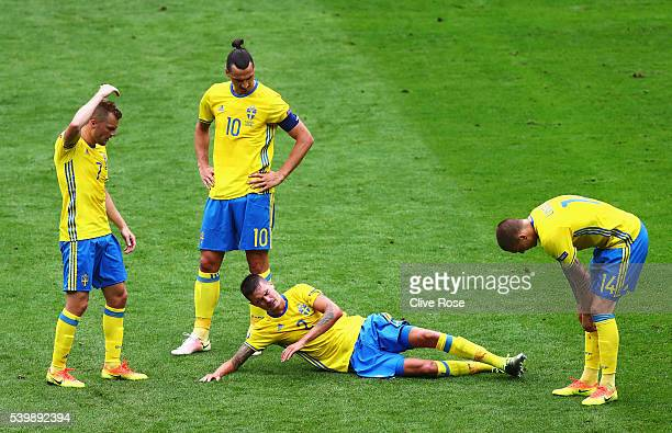 Mikael Lustig of Sweden lies injured during the UEFA EURO 2016 Group E match between Republic of Ireland and Sweden at Stade de France on June 13...