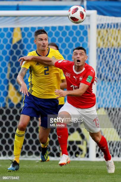 Mikael Lustig of Sweden national team and Blerim Dzemaili of Switzerland national team vie for the ball during the 2018 FIFA World Cup Russia Round...