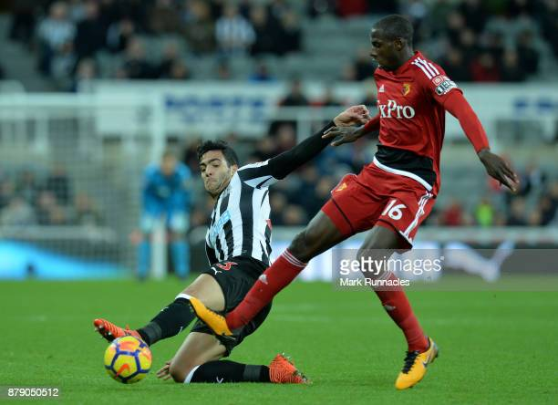 Mikael Merino of Newcastle United is challenged by Abdoulaye Doucoure of Watford during the Premier League match between Newcastle United and Watford...