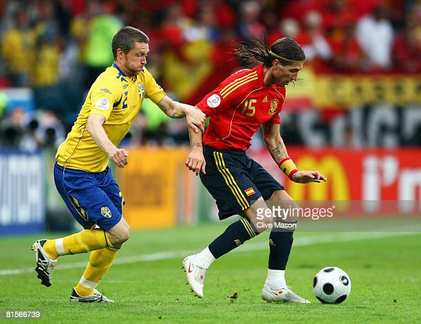 Mikael Nilsson of Sweden chases Sergio Ramos of Spain during the UEFA EURO 2008 Group D match between Sweden and Spain at Stadion Tivoli Neu on June...
