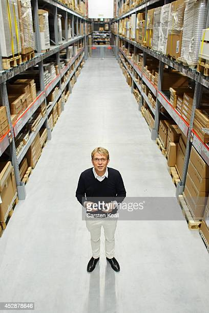 Mikael Ohlsson President and CEO of Ikea Group poses for the photographer between the shelves in the pick up field in the Ikea store in the Ikea of...