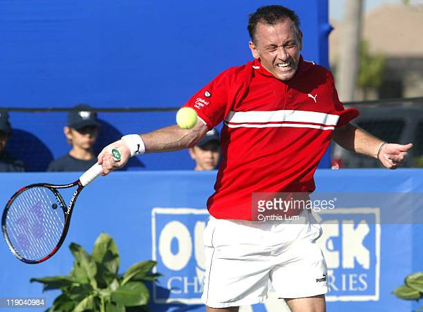 Mikael Pernfors of Sweden in action against Michael Chang of the USA at the Champions Cup Naples Naples FL Players Club Spa on March 11 2006