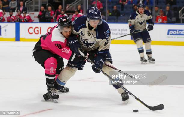 Mikael Robidoux of the Quebec Remparts and Vincent Lampron of the Sherbrooke Phoenix battle for the puck during the second period of their QMJHL...