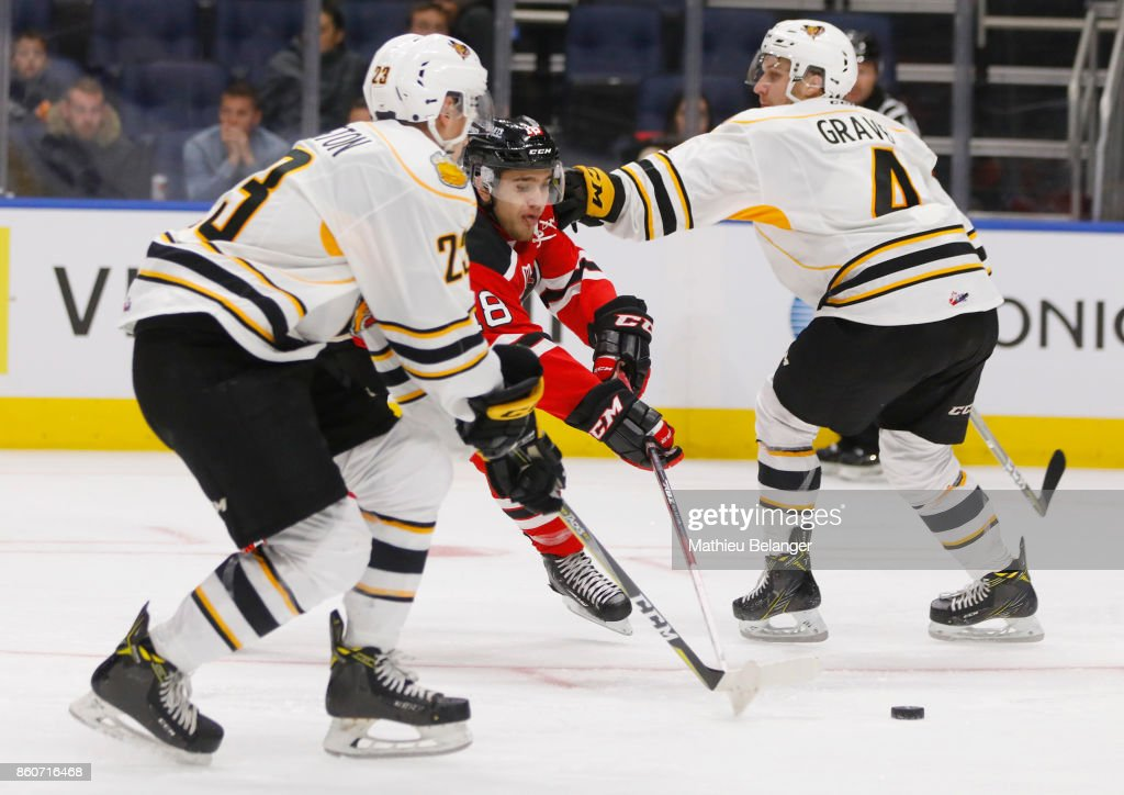 Mikael Robidoux #18 of the Quebec Remparts skates with the puck during the third period of their QMJHL hockey game at the Centre Videotron on October 12, 2017 in Quebec City, Quebec, Canada.
