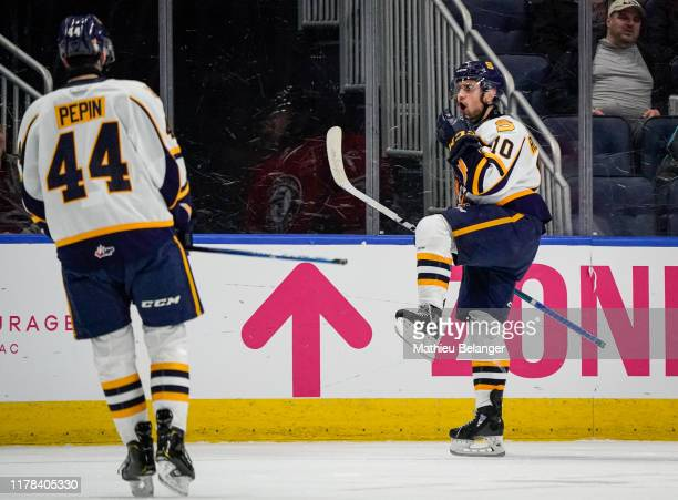 Mikael Robidoux of the Shawinigan Cataractes celebrates his goal against the Quebec Remparts during their QMJHL hockey game at the Videotron Center...
