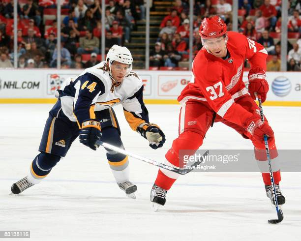 Mikael Samuelsson of the Detroit Red Wings protects the puck from Andrej Sekera of the Buffalo Sabres during a NHL preseason game on October 5 2008...