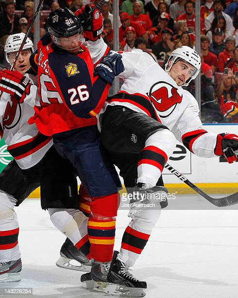 Mikael Samuelsson of the Florida Panthers and Adam Henrique of the New Jersey Devils come together in front of the net in the first period in Game...