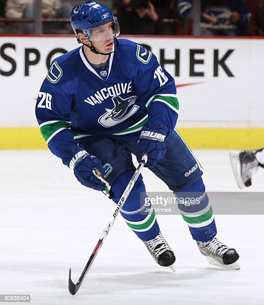 Mikael Samuelsson of the Vancouver Canucks looks on from the bench during their game against the Detroit Red Wings at General Motors Place on October...