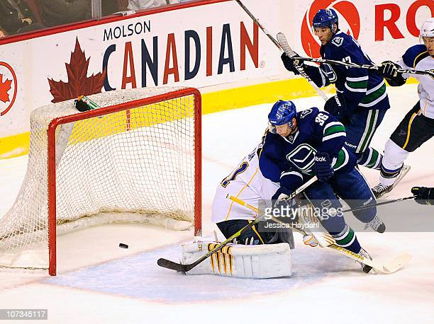 Mikael Samuelsson of the Vancouver Canucks scores on Jaroslav Halak of the St Louis Blues in the first period at Rogers Arena on December 5 2010 in...