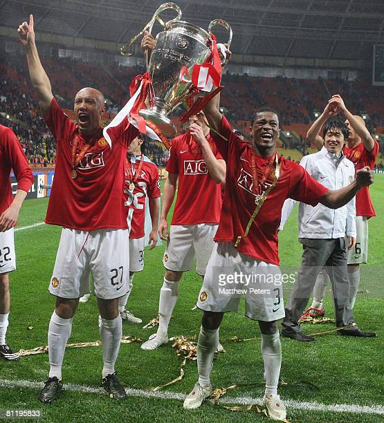 Mikael Silvestre and Patrice Evra of Manchester United celebrates with the trophy after winning the UEFA Champions League Final match between...
