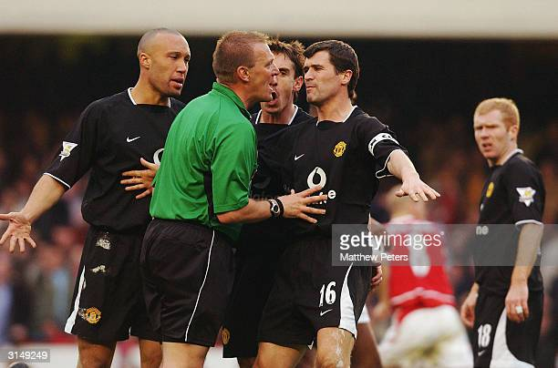 Mikael Silvestre Gary Neville and Roy Keane of Manchester United appeal to referee Graham Poll after Ryan Giggs was denied a penalty during the FA...