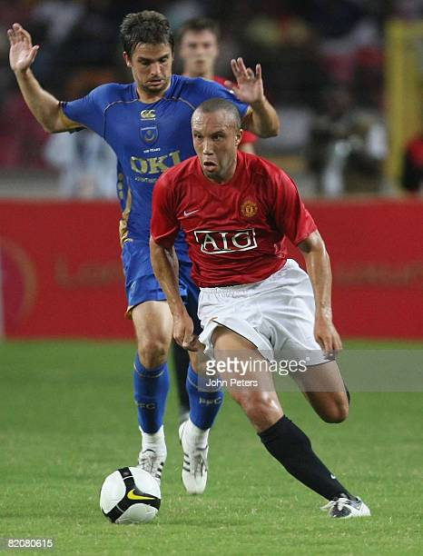Mikael Silvestre of Manchester United clashes with Niko Kranjcar during the preseason friendly match between Manchester United and Portsmouth during...