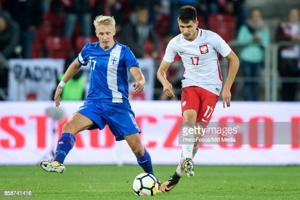 Mikael Soisalo of Finland and Bartosz Kapustka of Poland during the 2019 UEFA European Under21 Championship qualification game between Poland and...