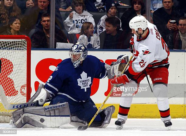 Mikael Tellqvist of the Toronto Maple Leafs is beat by Erik Cole for the Hurricanes first goal of the game February 23, 2004 at Air Canada Centre in...