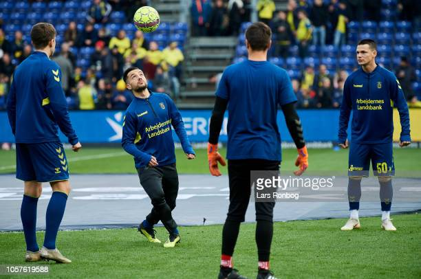 Mikael Uhre Besar Halimi goalkeeper Benjamin Bellot and Ante Erceg of Brondby IF in action during the warmup prior to the Danish Superliga match...