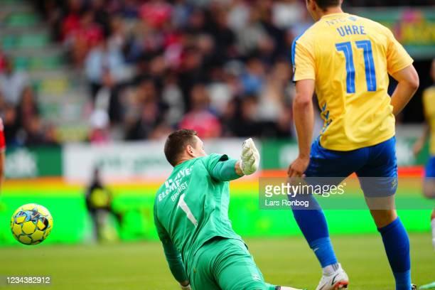 Mikael Uhre of Brondby IF scores the 0-1 goal against Goalkeeper Alexander Brunst-Zollner of Vejle Boldklub during the Danish 3F Superliga match...