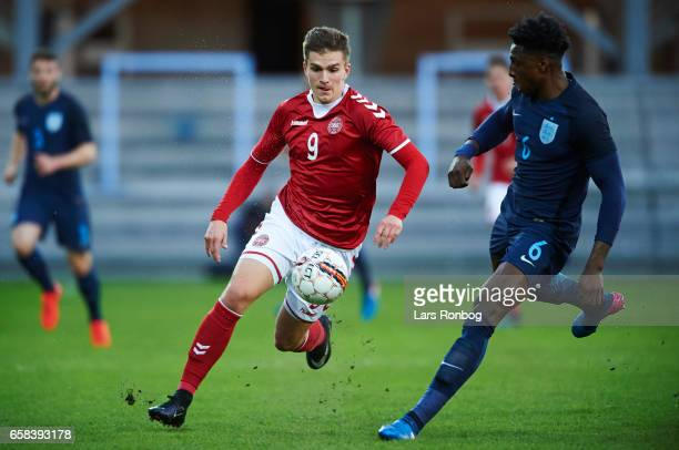 Mikael Uhre of Denmark U21 and Kortney Hause of England U21 compete for the ball during the U21 International friendly match between Denmark and...