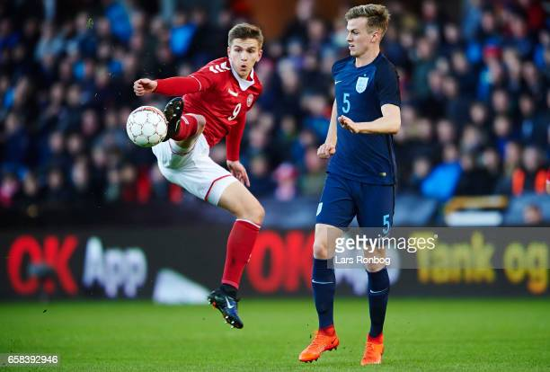 Mikael Uhre of Denmark U21 and Rob Holding of England U21 compete for the ball during the U21 International friendly match between Denmark and...