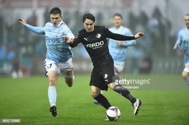 Mikael Uhre of SonderjyskE and Erik Marxen of Randers FC compete for the ball during the Danish Alka Superliga match between SonderjyskE and Randers...