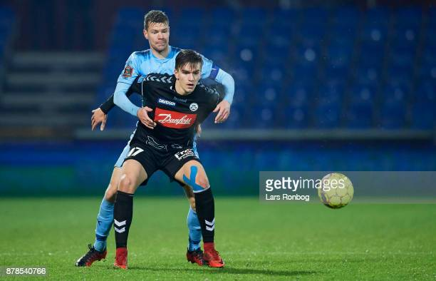 Mikael Uhre of Sonderjyske and Mads Agesen of Randers FC compete for the ball during the Danish Alka Superliga match between Randers FC and...