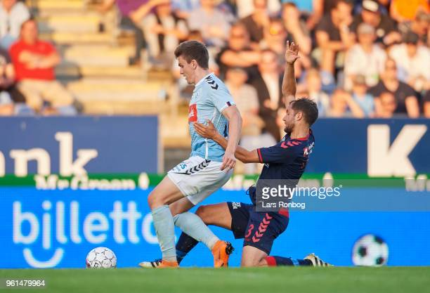 Mikael Uhre of Sonderjyske and Niklas Backman of AGF Aarhus compete for the ball during the Danish Alka Superliga Europa League Playoff match between...