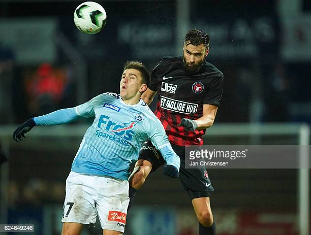 Mikael Uhre of SonderjyskE and Tim Sparv of FC Midtjylland compete for the ball during the Danish Alka Superliga match between SonderjyskE and FC...