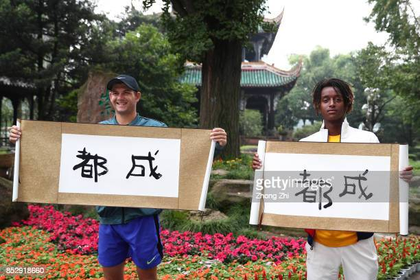 Mikael Ymer of Sweden and Jared Donaldson of the United States pose for photos with their calligraphy work during 2017 ATP Chengdu Open at...