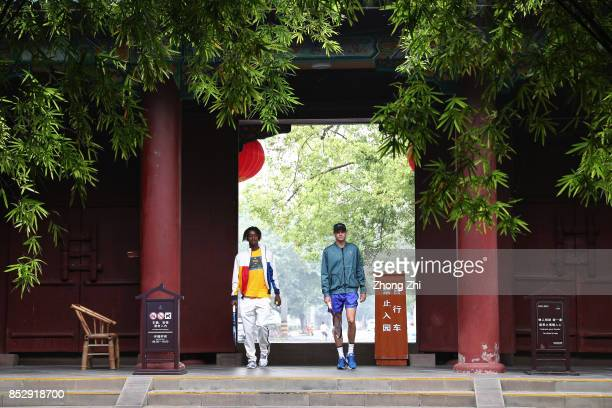 Mikael Ymer of Sweden and Jared Donaldson of the United States visit Wangjianglou Park during 2017 ATP Chengdu Open on September 24, 2017 in Chengdu,...