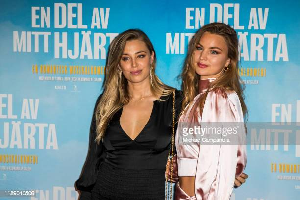 Mikaela Akerman and Jennifer Akerman pose for a picture on the red carpet during the premiere for A Piece Of My Heart at the Rigoletto cinema on...