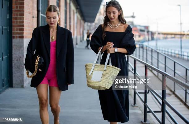 Mikaela Hållén wearing black Bottega Veneta bag, pink body and Felicia Akerstrom wearing Loewe basket bag is seen during Stockholm Fashion Week...