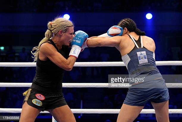 Mikaela Lauren from Sweden and Christina Hammer from Germany fight during their WBO WBF Middleweight World Championship fight between Christina...